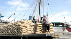 Workers at Paotere Port in Makassar, Indonesia Stock Footage