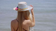 Gorgeous young blond woman in a sunhat Stock Footage