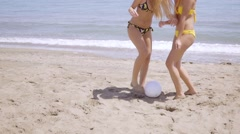 Two shapely young woman playing on a beach Stock Footage
