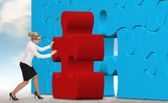 business woman building a red puzzle on a sky background. - stock photo