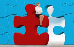 Business woman building a red puzzle on a sky background. Stock Photos