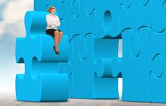 Business woman building a blue puzzle on a sky background. Stock Photos