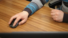 Hand on computer mouse - stock footage