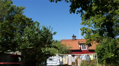 House of scenic small town in Sweden - Trosa - in the summer with blue sky Stock Footage
