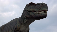 4K Tyrannosaurus rex life-size model in entertainment dino park Stock Footage