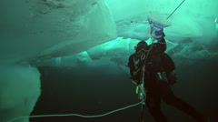 Man on the background of the ice under the water at geographic North Pole. Stock Footage