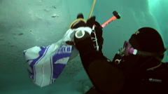 Man working with a hammer under the water at the North Pole. Stock Footage