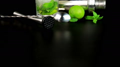 Mojito cocktail with fresh limes, mint and ice cubes, bar tools - stock footage