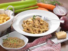 Traditional Italian meal of Pasta Ragu D'Agnello (Lamb Ragu) - stock photo