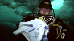 Diver takes a sample of ice under the water at the North Pole. Stock Footage
