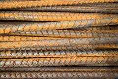 Horizontal MCU of semi-rusty steel bars stacked in a horizontal position Stock Photos