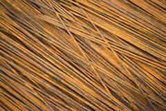 Horizontal MCU of semi-rusty steel bars stacked in a diagonal position - stock photo