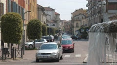 Mortara, Italy – circa May 2016: Traffic near the station fountain Stock Footage