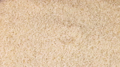 Rice Grains on black background Stock Footage