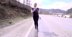 Sports girl runs nicely in the mountains Stock Footage