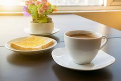 cup of coffee toast with butter. Morning light - stock photo