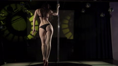 Sexy woman dancer in lingerie and platforms dancing sensual pole dance Stock Footage