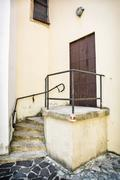 Old iron gate with railing and staircase to the church Stock Photos