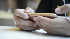 Unknown male use smartphone  for play a game Stock Footage