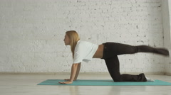 Young Beautiful Yoga Posing On a White Brick Wall Background, Healthy Lifestyle Stock Footage