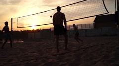 People Playing Volleyball at Sunset on the Beach. - stock footage