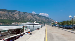 KOTOR, MONTENEGRO - JULY 21, 2015:  Cruise ship appears in bay and approaching Stock Footage