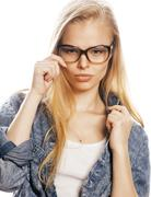 young pretty girl teenager in glasses on white isolated blond hair modern - stock photo