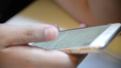 Unknown male use smartphone  for reading Stock Footage