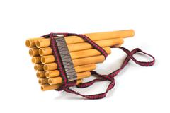 Pan flute on a white background - stock photo