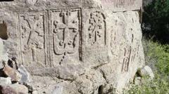 Khatchkars of sacred monastery of Geghard nearnYerevan, Armenia. - stock footage