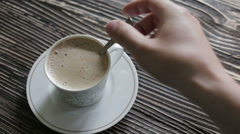 A cup of cappuccino with foam is on the table Stock Footage