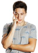 young attractive man isolated thinking emotional on white close up gesturing - stock photo