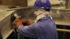 Man Using Grinder To Work Stock Footage