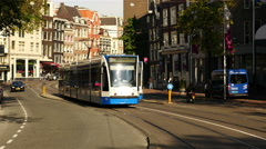 Trams, Traffic & People on a Busy Street in Amsterdam Netherlands Stock Footage