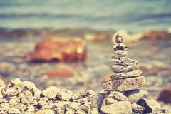 Vintage toned image of stones on a beach. - stock photo