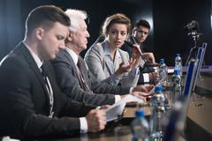 Scientist education debate Stock Photos