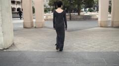 Woman walking in the city rear back view Stock Footage