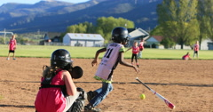 Young girls playing softball rural park slow DCI 4K Stock Footage