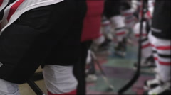Feet of hockey players wearing team uniform and blades, preparing for match Stock Footage