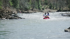 The rafting competition icluding the chasing ofleading sportsmen and others one Stock Footage