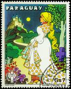 Cinderella going to the castle - scene from a fairy tale on postage stamp Stock Photos