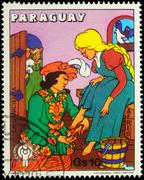 Cinderella and Prince - scene from a fairy tale on postage stamp Stock Photos