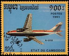 Passenger aircraft A310 on postage stamp - stock photo