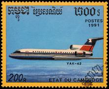 Passenger aircraft Yak-42 on postage stamp - stock photo