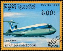 Passenger aircraft Tu-154 on postage stamp - stock photo