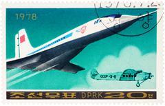 Soviet supersonic passenger aircraft Tu 144 on postage stamp - stock photo