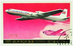 Passenger aircraft Ilyushin Il-18 on postage stamp - stock photo