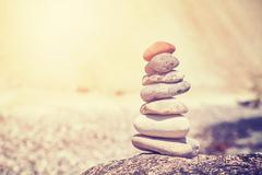 Vintage stylized stack of stones, shallow depth of field Stock Photos