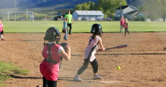 Young girl rural softball game slow motion DCI 4K Stock Footage
