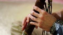 Indian music. Musician playing a musical instrument - flute Stock Footage